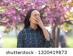 young pretty woman sneezing in... | Shutterstock . vector #1320419873