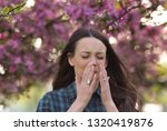young pretty woman sneezing in... | Shutterstock . vector #1320419876