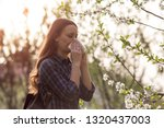 young pretty girl blowing nose... | Shutterstock . vector #1320437003