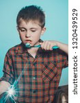 a sad boy in pajamas is not... | Shutterstock . vector #1320439529