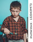 a sad boy in pajamas is not... | Shutterstock . vector #1320439973