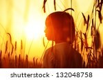 Boy On A Wheat Field At Sunset