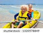 kids kayaking in ocean.... | Shutterstock . vector #1320578849