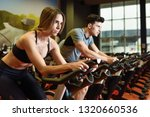young man and woman biking in... | Shutterstock . vector #1320660536