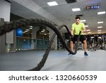 man with battle ropes exercise... | Shutterstock . vector #1320660539