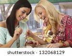 pretty female friends sharing a ... | Shutterstock . vector #132068129