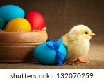 small chick with easter eggs