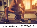 bodybuilder working out with...   Shutterstock . vector #1320784616