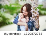 happy young woman holding her...   Shutterstock . vector #1320872786