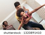 african american family... | Shutterstock . vector #1320891410
