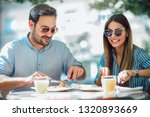 couple eating pizza snack...   Shutterstock . vector #1320893669