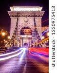 light trails on budapest chain...   Shutterstock . vector #1320975413