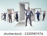 businessman in uncertainty... | Shutterstock . vector #1320987476