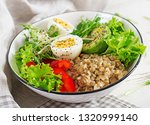 fresh salad. breakfast bowl... | Shutterstock . vector #1320999140