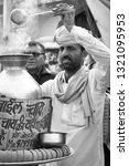 Small photo of PUSHKAR, INDIA - December, 2017: Man selling indian masala tea (chai wala) on the street of Pushkar town, India