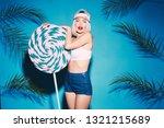 lovely girl posing with huge... | Shutterstock . vector #1321215689