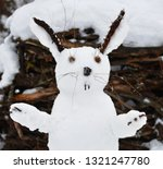 Stock photo snowman in the shape of a hare snow new year hare 1321247780