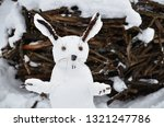 Stock photo snowman in the shape of a hare snow new year hare 1321247786