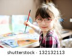 Cute Little Girl Painting A...