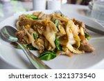 stir fry noodles  in white bowl.   Shutterstock . vector #1321373540