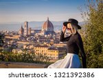 portrait of a woman in florence | Shutterstock . vector #1321392386