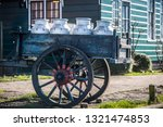 An Old Wheel Cart With Milk...