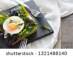 fried egg with bread toast on...   Shutterstock . vector #1321488140