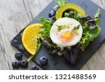 fried eggs with bread toast on...   Shutterstock . vector #1321488569