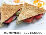 sandwich with ham and tomatoes...   Shutterstock . vector #1321530080