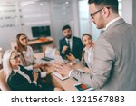 serious ceo talking to... | Shutterstock . vector #1321567883