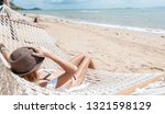 woman on hammock. lifestyle... | Shutterstock . vector #1321598129