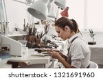 working all day. side view of...   Shutterstock . vector #1321691960