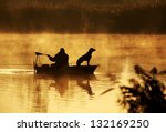 Silhouette Of Fisher And Dog...