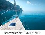 boat floats near the shore.... | Shutterstock . vector #132171413