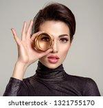 beautiful young woman looks... | Shutterstock . vector #1321755170