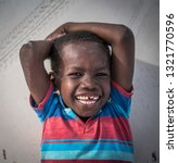 laughing african little boy | Shutterstock . vector #1321770596