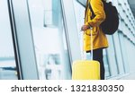 traveler in bright jacket with... | Shutterstock . vector #1321830350