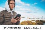 girl hold in hands mobile phone ... | Shutterstock . vector #1321856636