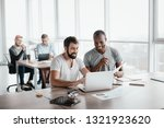 two business colleagues... | Shutterstock . vector #1321923620