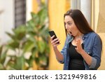 surprised woman checking online ...   Shutterstock . vector #1321949816