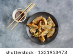 Fried dumplings Gyoza with shrimp filling and soy-ginger sauce.