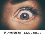 eye peeking through peep hole... | Shutterstock . vector #1321958639