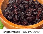dried grapes  raisins on wooden ... | Shutterstock . vector #1321978040