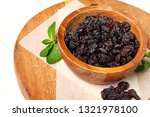 dried grapes  raisins on wooden ... | Shutterstock . vector #1321978100