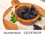 prunes with green leaf. close... | Shutterstock . vector #1321978139