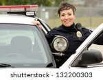 A Female Police Officer Smiling ...