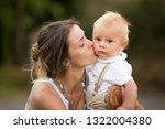 mom and baby boy outdoor.... | Shutterstock . vector #1322004380