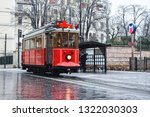 red nostalgic tram is moving on ... | Shutterstock . vector #1322030303