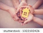 adult and child hands holding... | Shutterstock . vector #1322102426