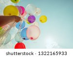 hand holding multi colored... | Shutterstock . vector #1322165933